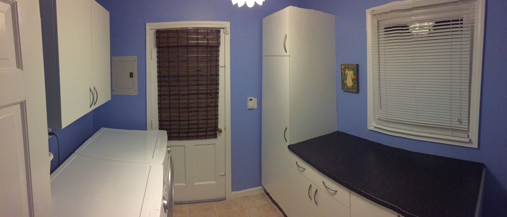 Cornflower blue laundry room make-over with white kitchen cabinets