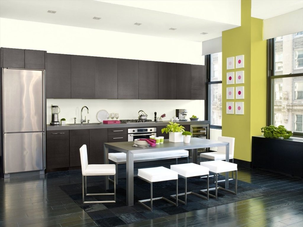 Modern kitchen with Benjamin Moore Grape Green accent wall paint